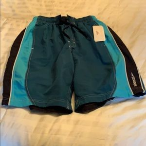 Men's speedo bathing suit trunks in size medium.